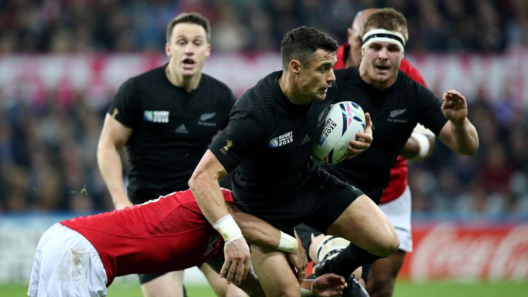 New Zealand fly-half Dan Carter is tackled by Siale Piutau