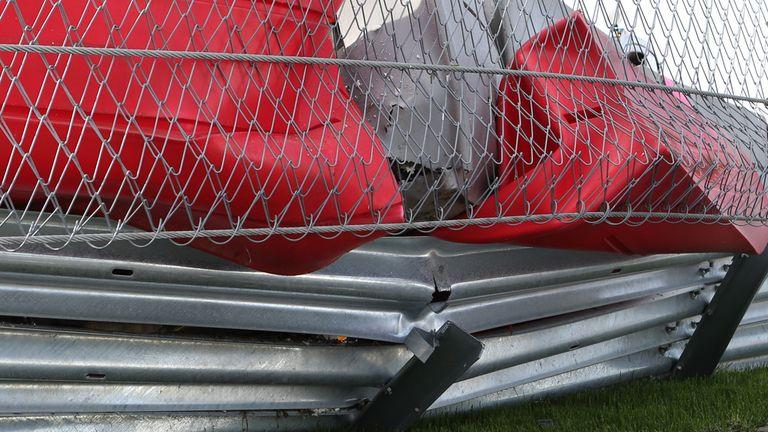 The damaged barriers after Carlos Sainz's crash