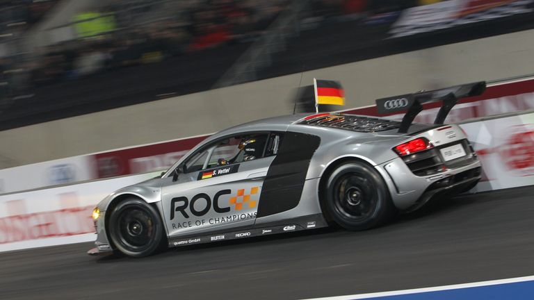 Sebastian Vettel tests his skills in an Audi R8