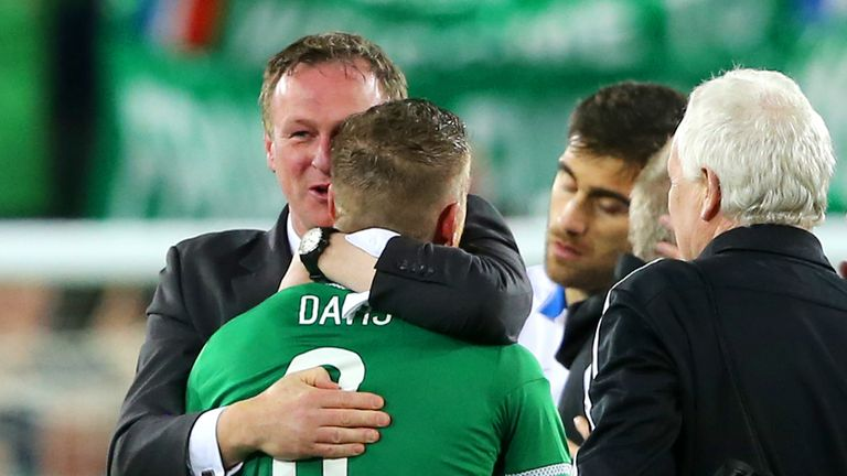 Northern Ireland boss Michael O'Neill congratulates Steven Davis after the final whistle of the UEFA European Championship Qualifying match at Windsor Park