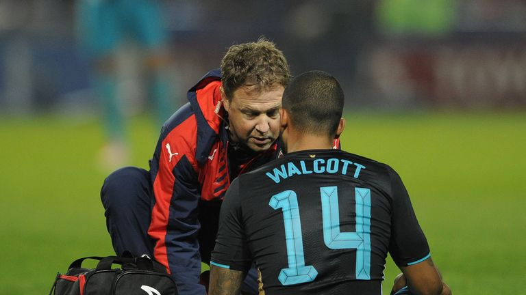 Arsenal's Theo Walcott is treated during the 3-0 defeat to Sheffield Wednesday