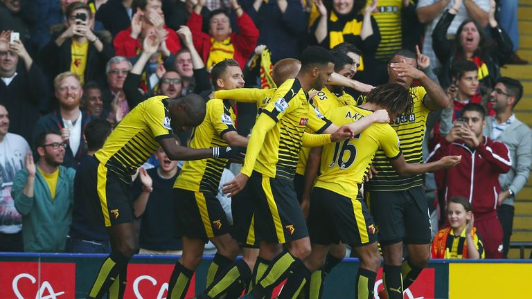 Watford players celebrate after Odion Ighalo (obscured) gave the Hornets a 1-0 advantage against West Ham