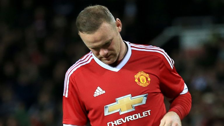 Manchester United's Wayne Rooney dejected after missing his penalty during the shootout following the Capital One Cup, Fourth Round match at Old Trafford,