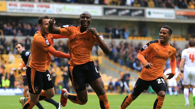 Afobe (centre) was too much to handle for Huddersfield