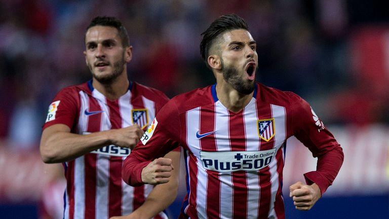 Yannick Carrasco of Atletico de Madrid celebrates scoring their second goal during the La Liga match against Valencia