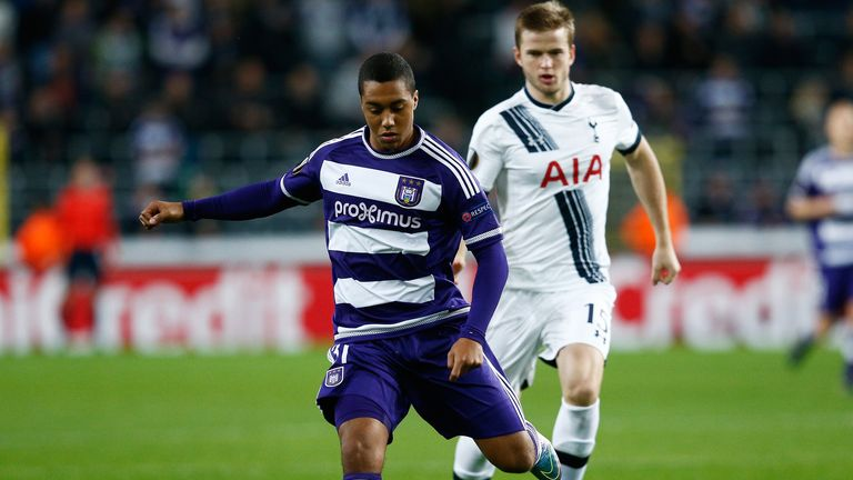 Yoeri Tielemans is chased down by Eric Dier