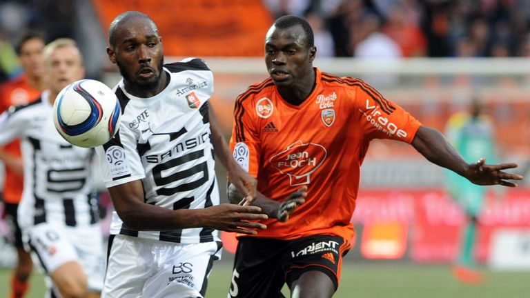Lorient's Zargo Toure (R) vies with Rennes' Giovanni Sio