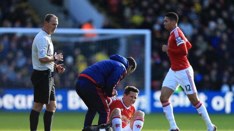 Ander Herrera receives treatment for a hamstring injury during Manchester United's game at Watford