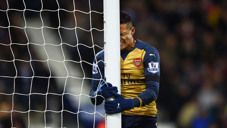 Alexis Sanchez of Arsenal reacts after missing a chance against West Brom