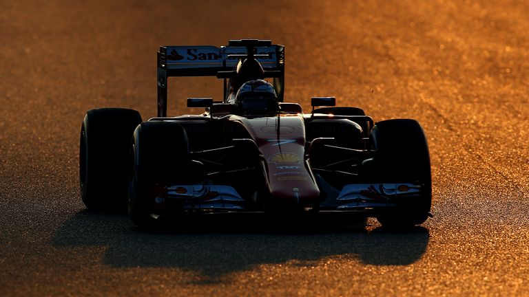 In the red: Kimi Raikkonen tests the new Ferrari at Barcelona - Picture by Mark Thompson, Getty Images