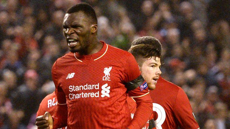 Liverpool's Zaire-born Belgian striker Christian Benteke (L) celebrates after scoring during a UEFA Europa League