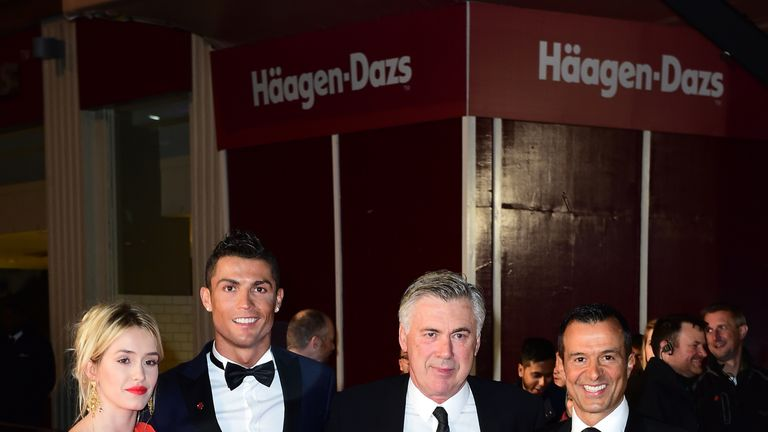 A guest, Cristiano Ronaldo, Carlo Ancelotti and Jorge Mendes attending the world premiere of Ronaldo at Vue West End Cinema in Leicester Square