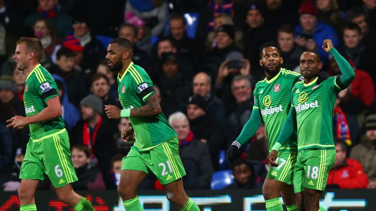 Defoe (right) celebrates his winning goal at Crystal Palace