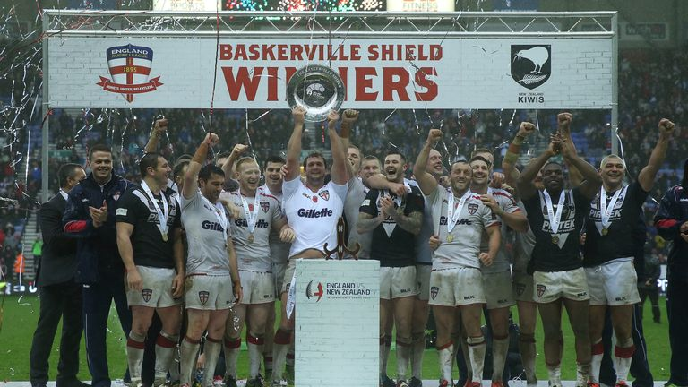 England celebrate with the Baskerville Shield after beating New Zealand at the DW Stadium
