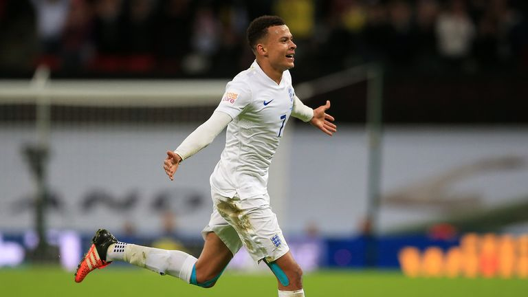 England's Dele Alli celebrates scoring his side's first goal during the international friendly match at Wembley Stadium, London.