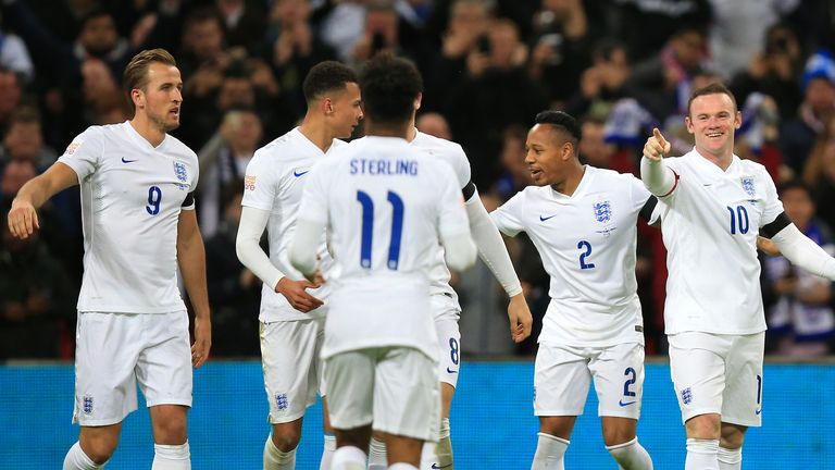 England's Wayne Rooney celebrates scoring his sides second goal of the match with team-mates during the international friendly match at Wembley Stadium