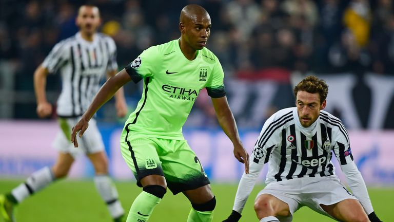 Fernandinho of Manchester City controls the ball as Claudio Marchisio of Juventus closes in
