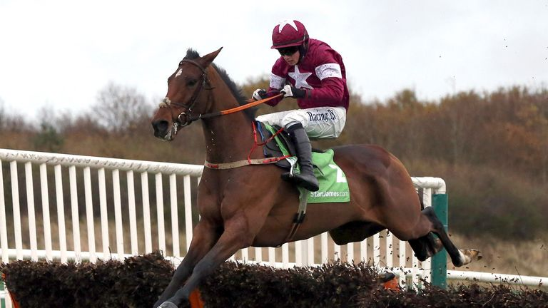 Identity Thief, rdiden by Bryan Cooper, jumps the last to win the  StanJames.com Fighting Fifth Hurdle