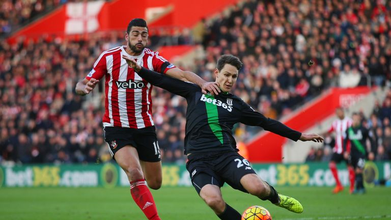 Graziano Pelle of Southampton and Philipp Wollscheid of Stoke City compete for the ball