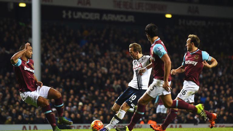 LONDON, ENGLAND - NOVEMBER 22: Harry Kane of Tottenham Hotspur scores his teams third goal during the Barclays Premier League match between Tottenham Hotsp