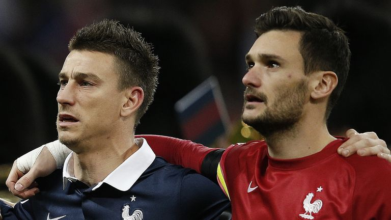 France's goalkeeper and captain Hugo Lloris (right) and defender Laurent Koscielny sing their country's national anthem