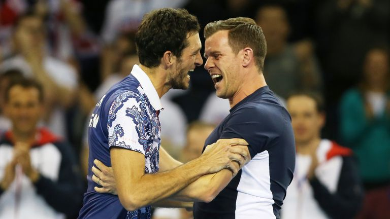 James Ward celebrates with captain Smith after beating the USA's John Isner