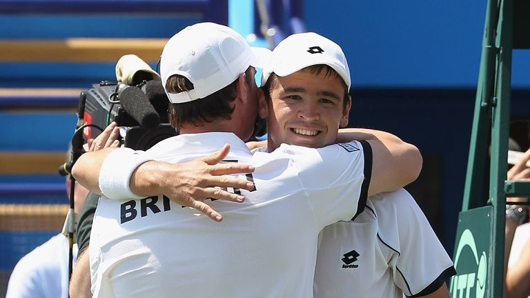 Captain Leon Smith hugs Jamie Baker during his first tie in charge against Turkey in 2010