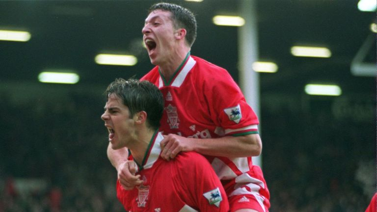Redknapp celebrates with Robbie Fowler at Anfield
