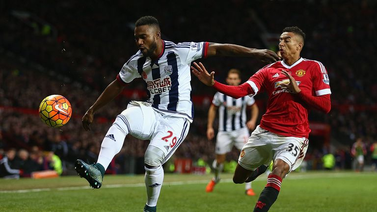 Stephane Sessegnon of West Bromwich Albion in action with Jesse Lingard of Manchester United