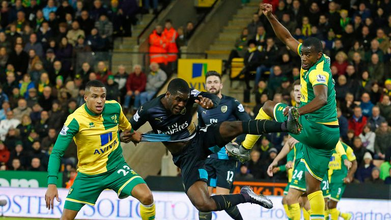 Arsenal's Joel Campbell (2nd L) vies with Norwich City's Martin Olsson (L) and Sebastien Bassong