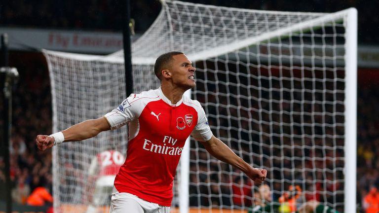 Kieran Gibbs celebrates scoring Arsenal's equalising goal against Tottenham Hotspur at the Emirates Stadium on November 8, 2015