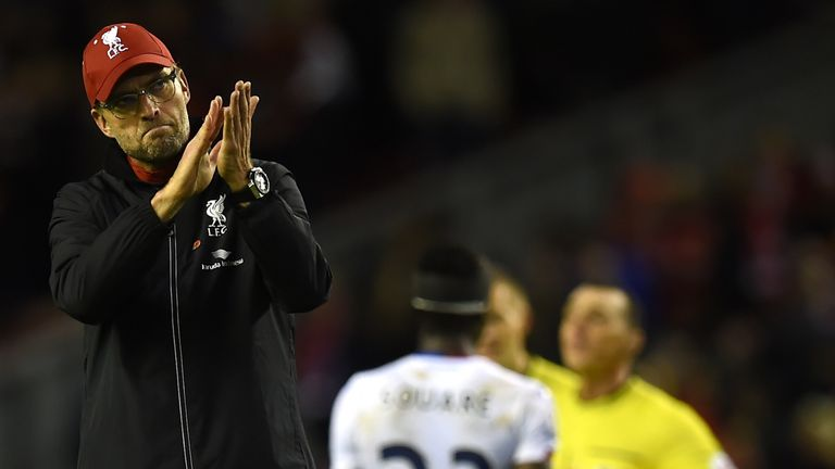 Jurgen Klopp (L) applauds the fans after losing to Palace