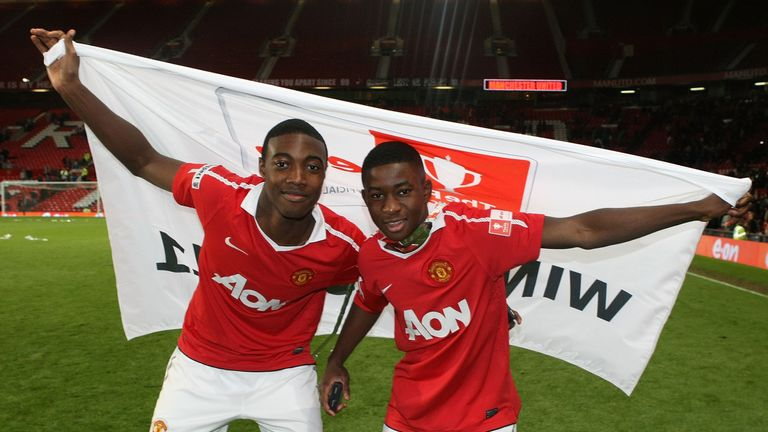 Cole (right) celebrates the 2011 FA Youth Cup triumph with Tyler Blackett