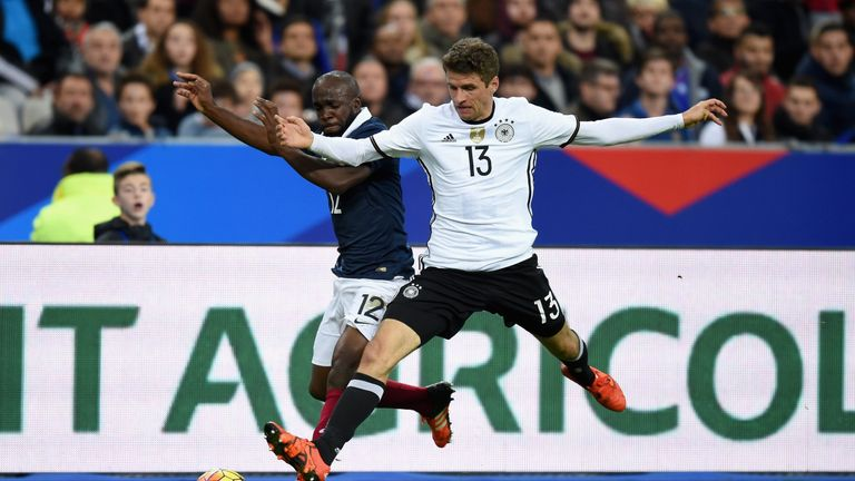 Lassana Diarra of France (L) battles for the ball with Thomas Muller of Germany