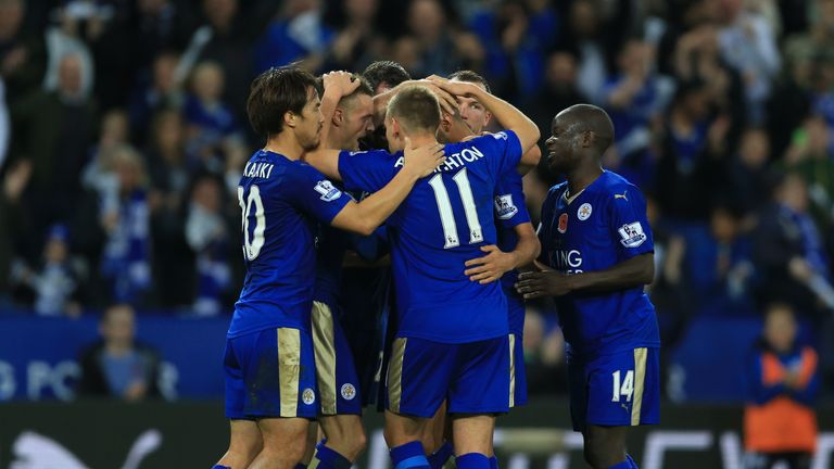 Leicester City's Jamie Vardy (second left) celebrates scoring his side's second goal of the game during the Barclays Premier League match against Watford