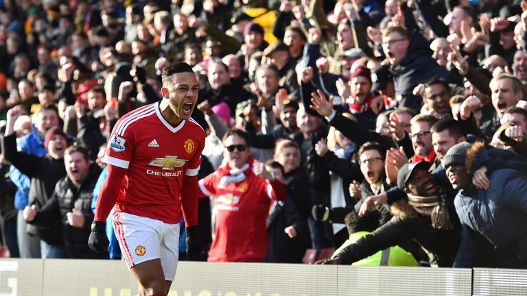 Man Utd's Memphis Depay celebrates scoring the opening goal against Watford.