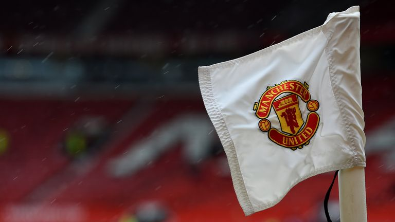 The Manchester United badge is seen on a corner flag