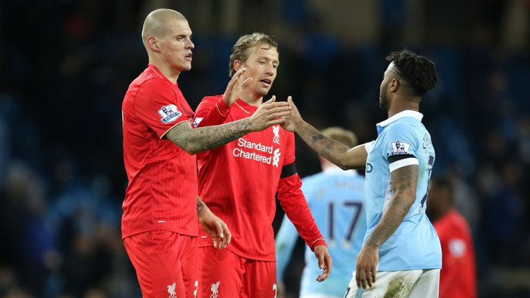 Manchester City's Raheem Sterling is consolled by Liverpool's Martin Skrtel and Liverpool's Lucas Leiva