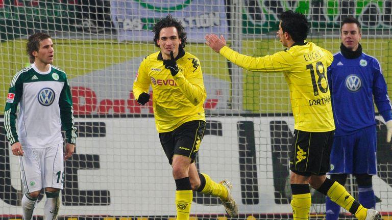 Mats Hummels celebrates making it 3-0 in Borussia Dortmund's Bundesliga win over Wolfsburg in January 2011