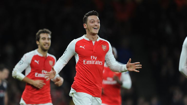 Mesut Ozil celebrates scoring Arsenal's first goal during the UEFA Champions League match against Dinamo Zagreb