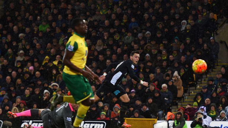 Mesut Ozil of Arsenal scores