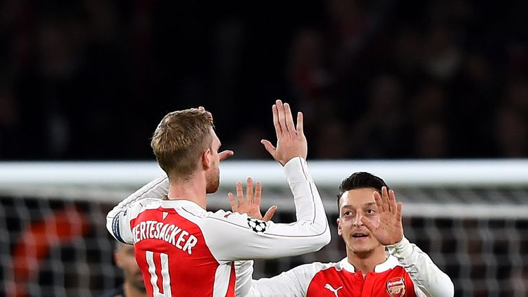 Arsene Wenger believes Mesut Ozil and Per Mertesacker have invaluable in the Arsenal dressing room