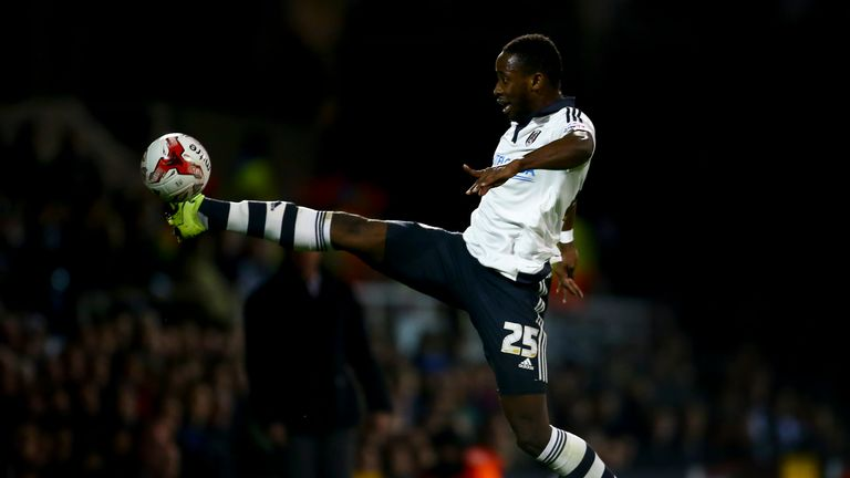 Moussa Dembele of Fulham reaches for a ball