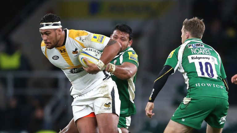 Nathan Hughes of Wasps is tackled during one of 24 carries for Wasps