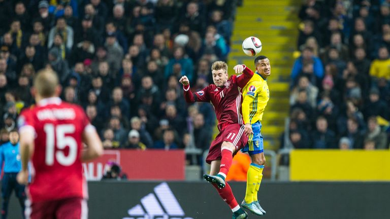 Nicklas Bendtner goes up for ariel duel with Martin Olsson