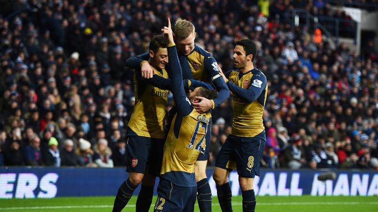 Olivier Giroud of Arsenal celebrates scoring his team's first goal against West Brom.