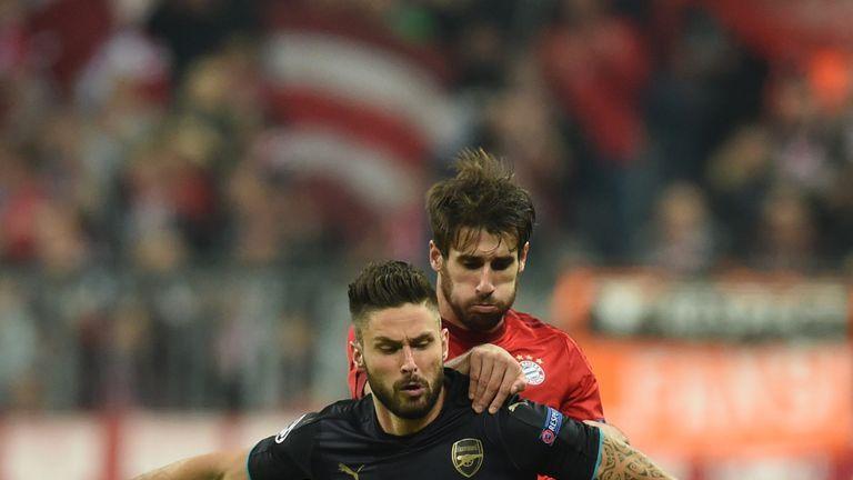 Olivier Giroud battles with Javi Martinez in the first half