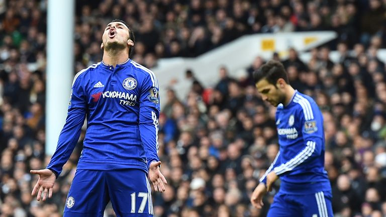 Chelsea midfielder Pedro (left) reacts after missing a shot on goal
