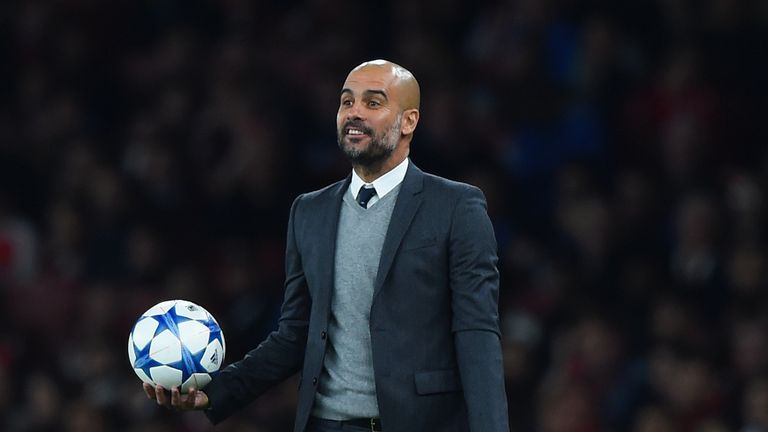 Bayern Munich boss Pep Guardiola reacts during Champions League match against Arsenal at Emirates Stadium on October 20, 2015