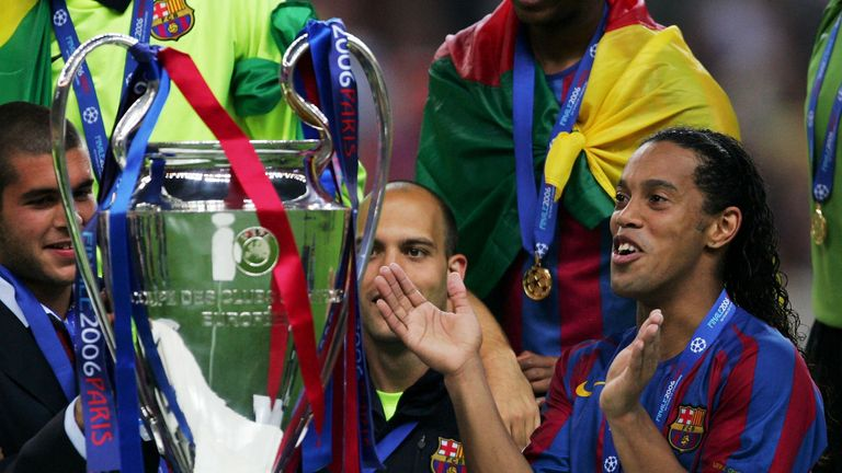 PARIS - MAY 17:  Ronaldinho (C) of Barcelona waits to hold the trophy alongside celebrating team mates after they win the UEFA Champions League Final betwe